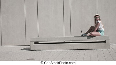 Woman On Bench Using Laptop