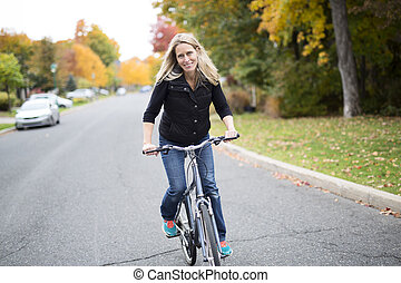 Woman on bicycle smiling