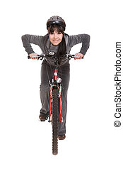 woman on bike - attractive brunette woman with bike. over ...