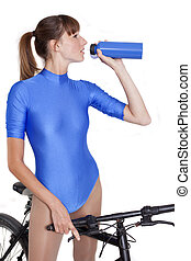 woman on bike drinking water