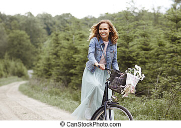 Woman on bike in forest