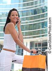 Woman on bike on the phone