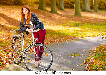 Woman on bike outdoor