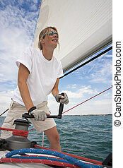 Woman On Board A Yacht - Shot of beautiful young woman on ...