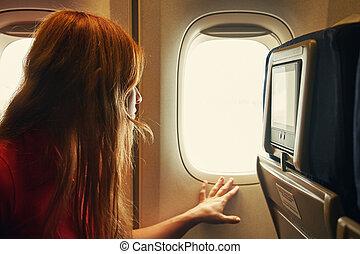 woman on board an airplane