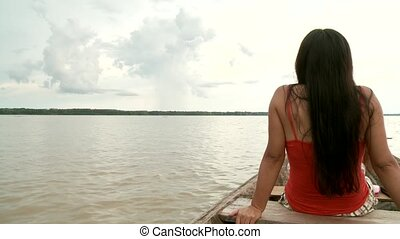 Woman On Boat - Paddeling On Amazon River