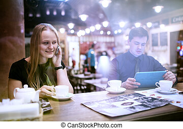 Woman on cellphone drinking coffee
