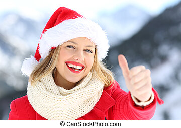 Woman on christmas holidays with thumbs up