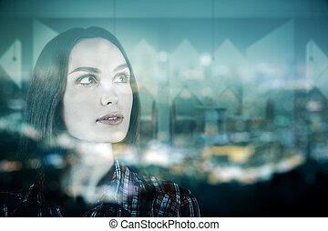 Woman on city background multiexposure
