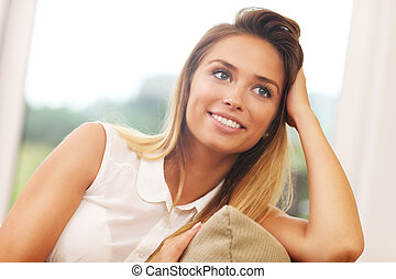 Woman on couch in living room