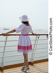 Woman on deck of a cruise liner
