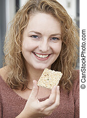 Woman On Diet Eating Crispbread At Home