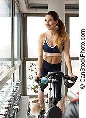 Woman on exercise bike