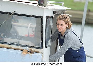 Woman on fishing vessel