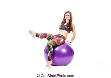 Woman on fitness ball