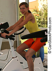 woman on fitness bicycle