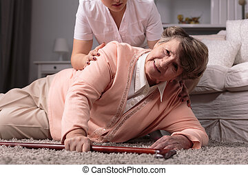 Woman on floor - Disabled older woman on floor and caring...