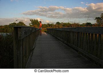 Woman on Foot Bridge