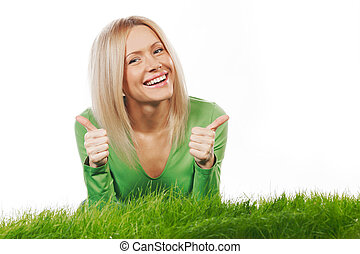 Woman on grass with thumbs up