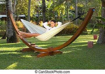 Woman on hammock - 20-25 years woman portrait ralaxing on...
