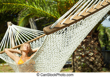woman on hammock - woman relaxing on hammock with eyes...