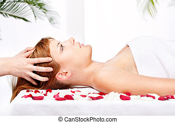 woman on head massage treatment in salon