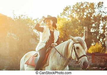 woman on horse in hat