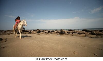 Woman On Horse Riding At Beach