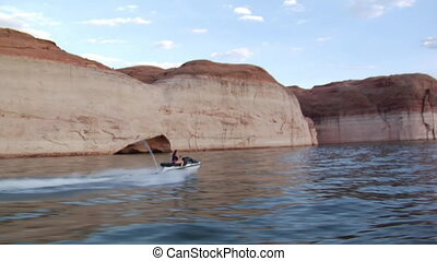 woman on jet ski with red rock cliffs