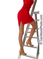 Woman in red dress climbs to the top of the latter of succes