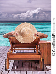 Woman on luxury beach resort