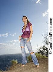 Woman on Maui coast.