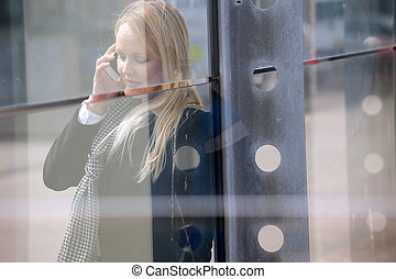 Woman on mobile phone outdoors