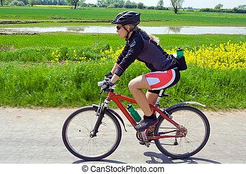 Woman on mountain bike in summer