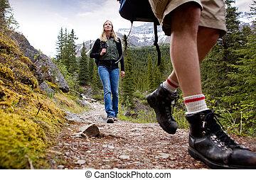 Woman on Mountain Hike - A happy woman on a mountain trail ...