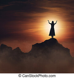 Woman on mountain. - Woman on mountain in praise and...