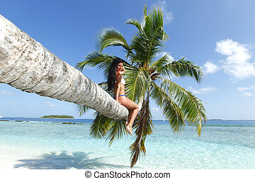 Woman on palm on sea background
