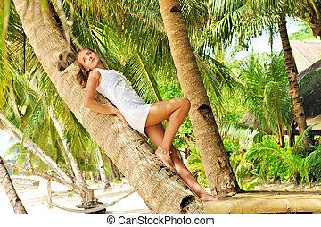 Woman on palm tree