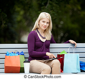 Woman on Park Bench with Digital Tablet