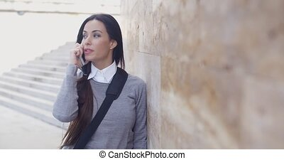 Woman on phone with atonished expression - Astonished young...