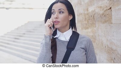 Woman on phone with atonished expression