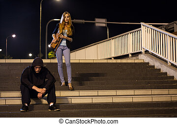 Woman on railway station at night