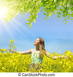 woman on rapeseed field - Young happy woman on blooming ...