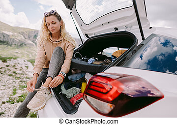 woman on road trip in mountains