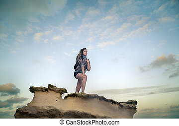 Woman on rock