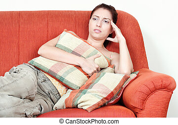 woman on sofa having headache