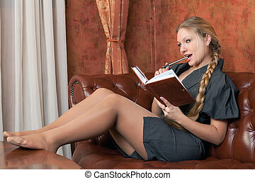 Woman on sofa with notebook