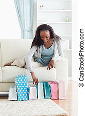 Woman on sofa with shopping
