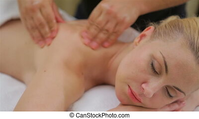 Woman on spa massage of shoulder