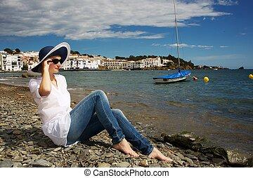 Woman on stony beach.